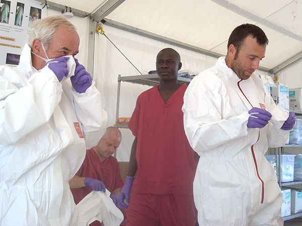 KBR employees preparing to enter the Ebola patient area to carry out maintenance tasks