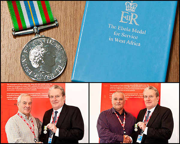 Richard Card presents Dave Butler and Jon Stewart with the Ebola Medal for Service Awards from the UK Government