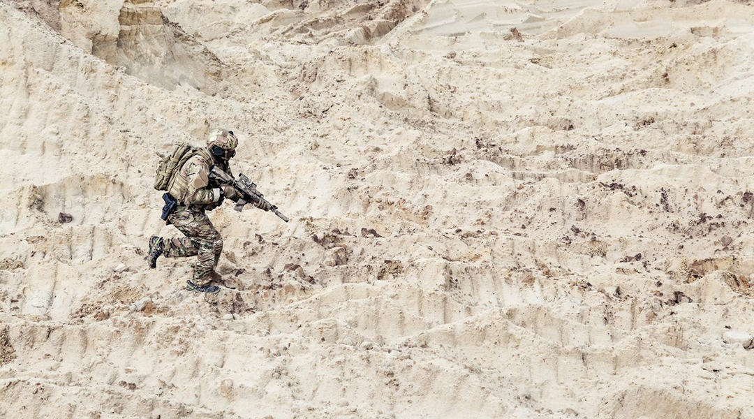 US Soldier in the sand dunes